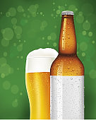 Beer glass and bottle with blank label on green background