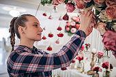 Woman making wedding decoration