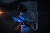 Cosmonaut on a mission on dark Mars