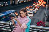 Woman with camera in city