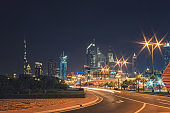 Night landscape with views of the skyscrapers and the Burj Khalifa from the side of the road