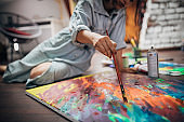 Creative woman painting in her studio