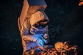 Man astronaut on a mission on Mars