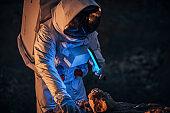 Astronaut on a mission on dark Mars