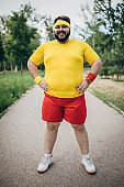 Overweight man in sport clothing