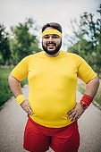 Overweight man in sport clothing portrait