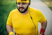 Overweight man jogging