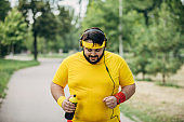 Overweight man jogging to lose weight