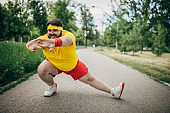 Overweight man stretching