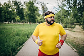 Overweight man training