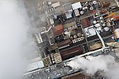 Smoke over paper mill, aerial view