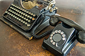 Closeup of old typewriter and telephone