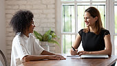 HR manager holding job interview with skilled african ethnicity woman.