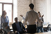 Businessman stand holding business briefing with employees
