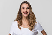 Cheerful happy funny millennial woman laughing looking at camera