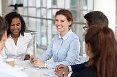 Multiracial business people take a break during negotiations joking laughing