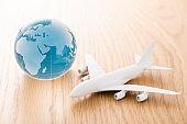 Miniature airplane and globe