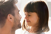 Close up of dad make surprise playing with little daughter
