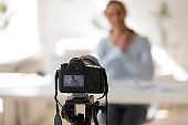 Businesswoman recording video blog on professional digital equipment