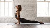 Woman practicing yoga, upward facing dog, Urdhva mukha shvanasana