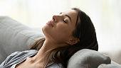 Beautiful healthy young woman taking deep breath of fresh air
