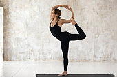 Young woman practicing yoga, Natarajasana, Lord of the Dance pose