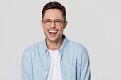 Funny guy nerd wearing glasses laughing looking at camera