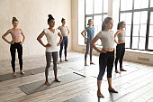 Toned diverse girls stand barefoot ready for fitness training