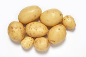 A pile of small potatoes on white background