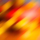 Abstract blurred background, diagonal yellow red brown spots.