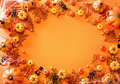 Halloween decoration on orange color background top view with copy space