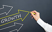 man drawing arrow. growth concept