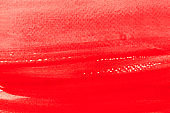 Bright red watercolor background. Horizontal hand drawn red liquid ink colors blending.