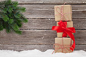 Christmas gift boxes and xmas fir tree branch