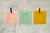 Blank colorful photo frames hanging.