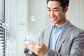 Global business network concept. Asian businessman using global communication phones.