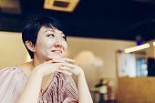 Beautiful Asian woman relaxing at the cafe.