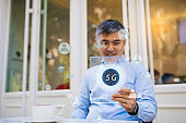 Asian businessman use global communication phones in the 5g system. Futuristic business concept.
