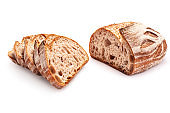 Slice of sourdough whole wheat freshly baked bread on white background