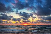 Beautiful cloudscape over the sea waves. Sunrise and tropical beach
