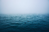 Sea ripple water with morning fog.