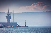 Sea port Varna, Bulgaria and beautiful morning landscape. Lighthouse, fishing boats, yachts and navigation tower