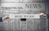 what to do ?-  newspaper slogan title