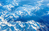 Airplane view of mountains covered with snow