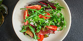 Healthy salad, tomato, leaves mix salad (mix micro greens, onion, other ingredients). food background. copy space