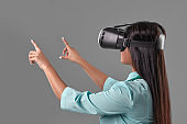 Young attractive doctor in a virtual reality glasses