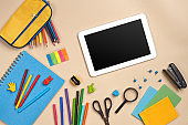 Flat lay photo of workspace desk with school accessories or office supplies