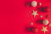 Christmas composition. Golden and red decorations on red background. Christmas, winter, new year concept. Flat lay, top view, copy space