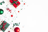 Christmas composition. Gifts, red and green decorations on white background. Christmas, winter, new year concept. Flat lay, top view, copy space
