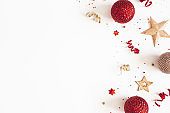 Christmas composition. Red and golden decorations on white background. Christmas, winter, new year concept. Flat lay, top view, copy space